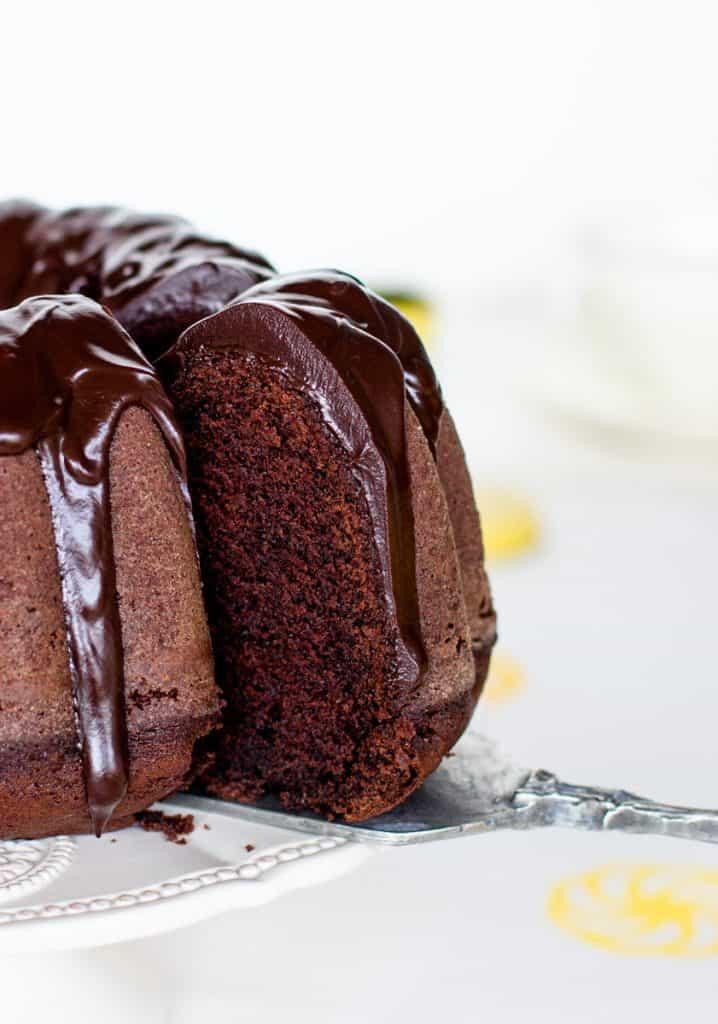 Removing slice from glazed chocolate bundt cake