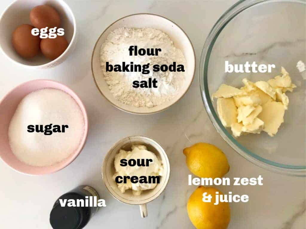Lemon Pound Cake ingredients in bowls on white surface