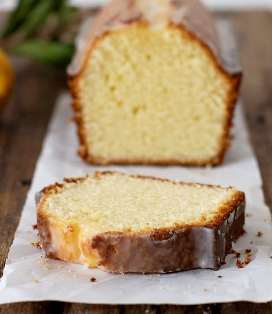 Close up cut slice of pound cake on parchment paper