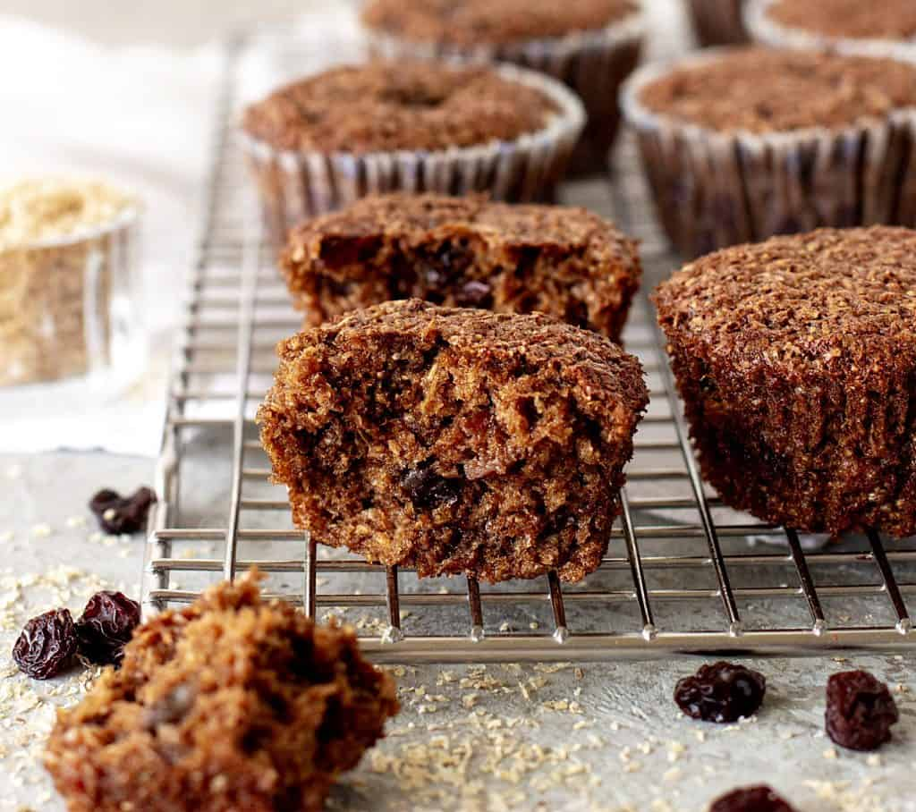 Cut bran muffin on wire rack with whole muffins, loose raisins