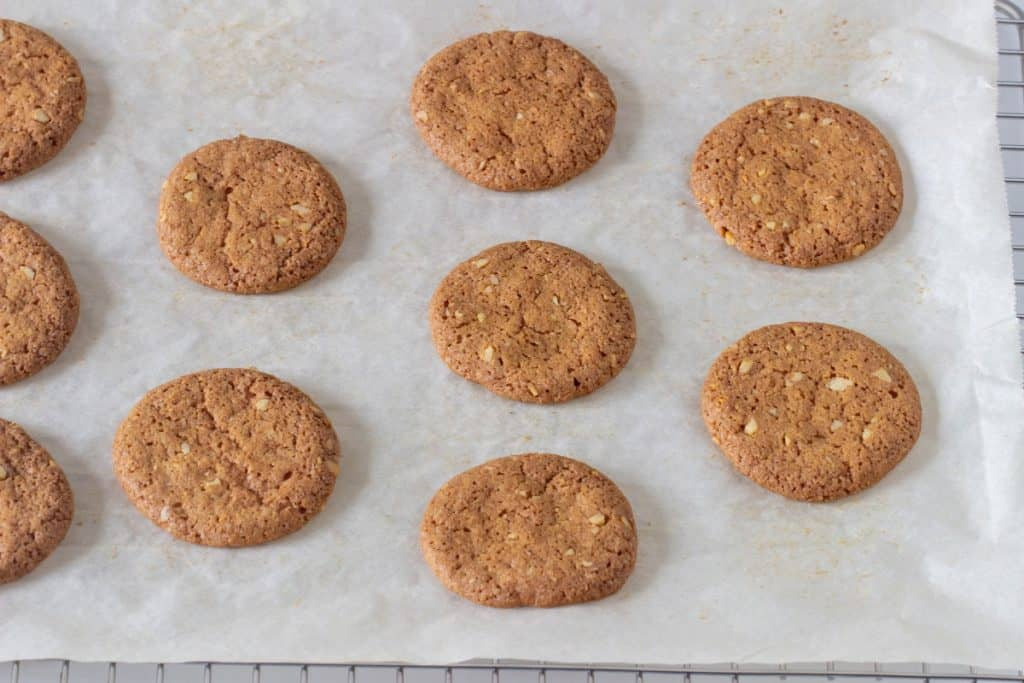 Baked walnut cookies on white parchment paper