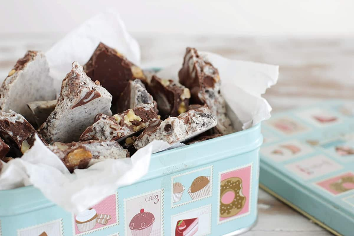 Double chocolate bark in pastel color box, silk paper, white table