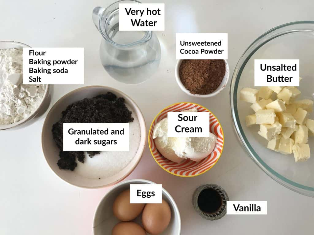 Chocolate Bundt Cake ingredients.in bowls on white table