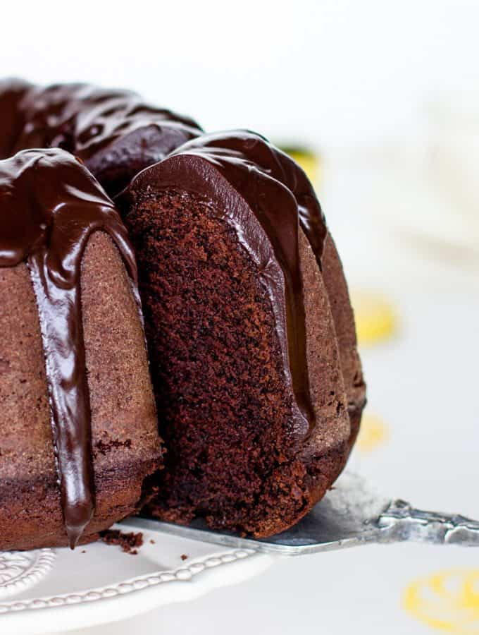 Removing slice from glazed chocolate bundt cake
