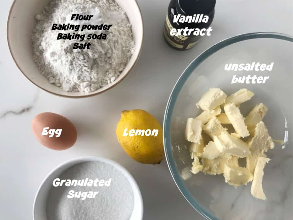 Lemon Crinkle Cookies ingredients.in bowls on white surface