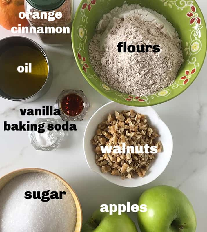 Apple Loaf cake ingredients in bowls on white surface