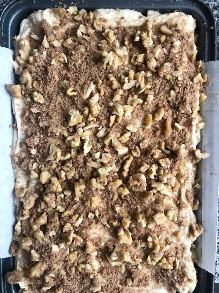 Air view of unbaked apple walnut crumble cake in pan