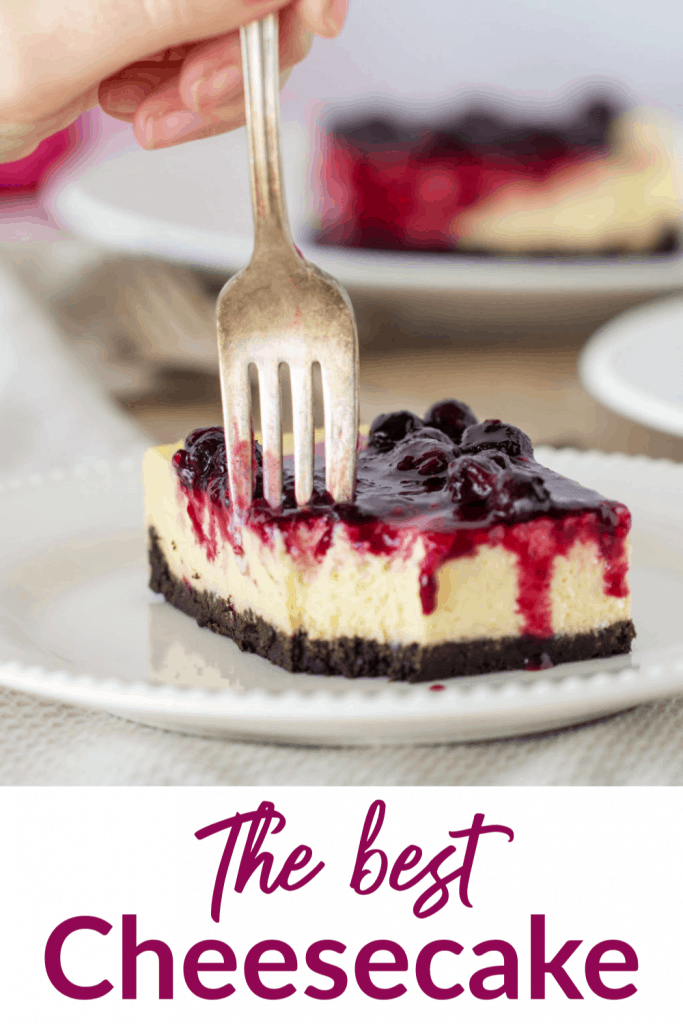 Slice of cheesecake with fork, long pin with text