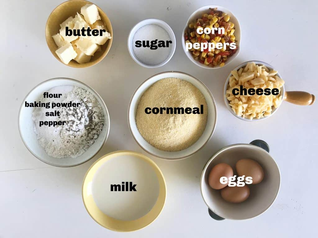 Jalapeño cornbread ingredients in bowls on white surface