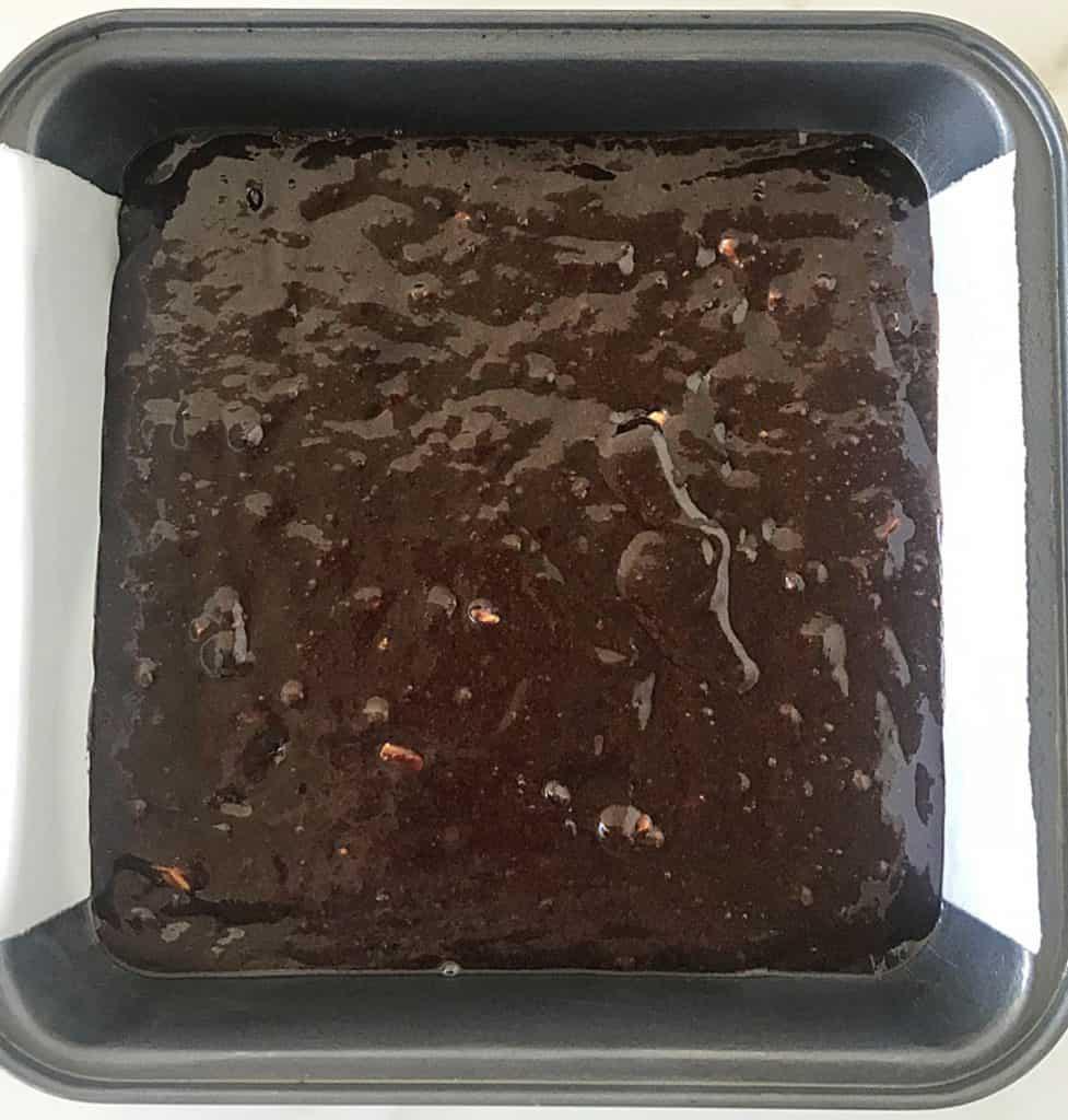 Metal pan with raw brownie batter