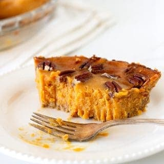 Eaten piece of sweet potato pie on white plate with fork