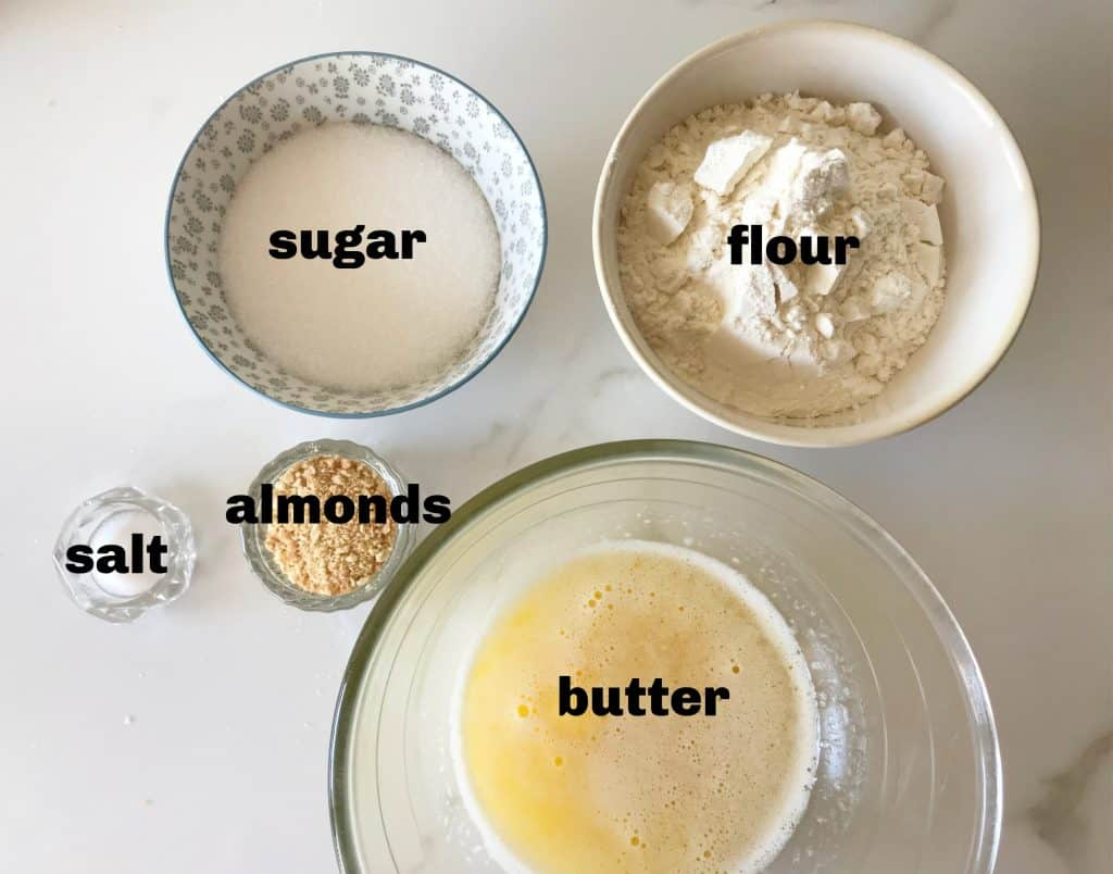 Crust ingredients in bowls on white surface