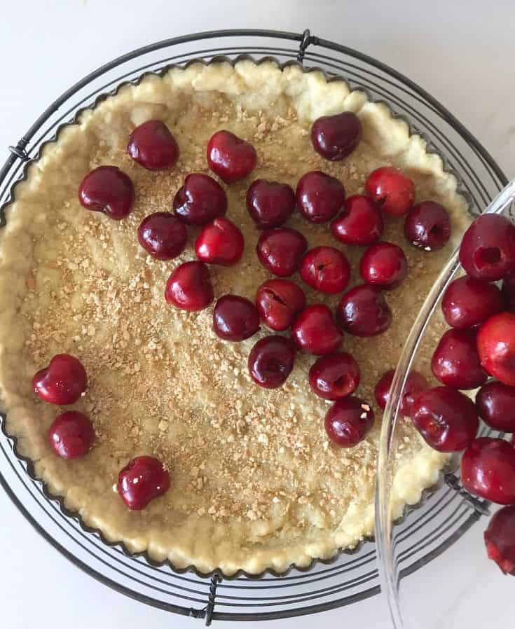 Filling tart crust with fresh cherries