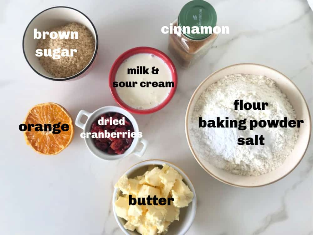 Cranberry Orange Scone ingredients in bowls on white surface