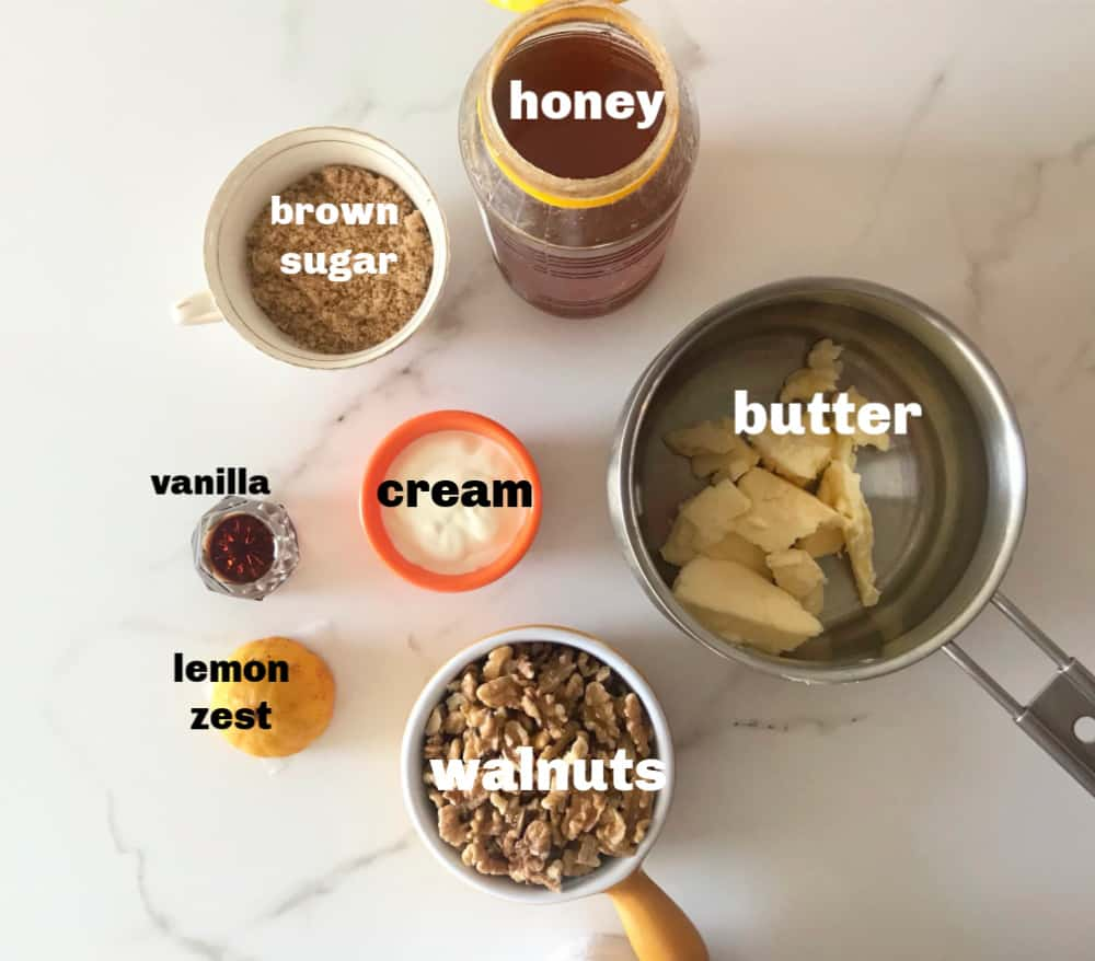 Honey walnut bars ingredients in bowls on white surface