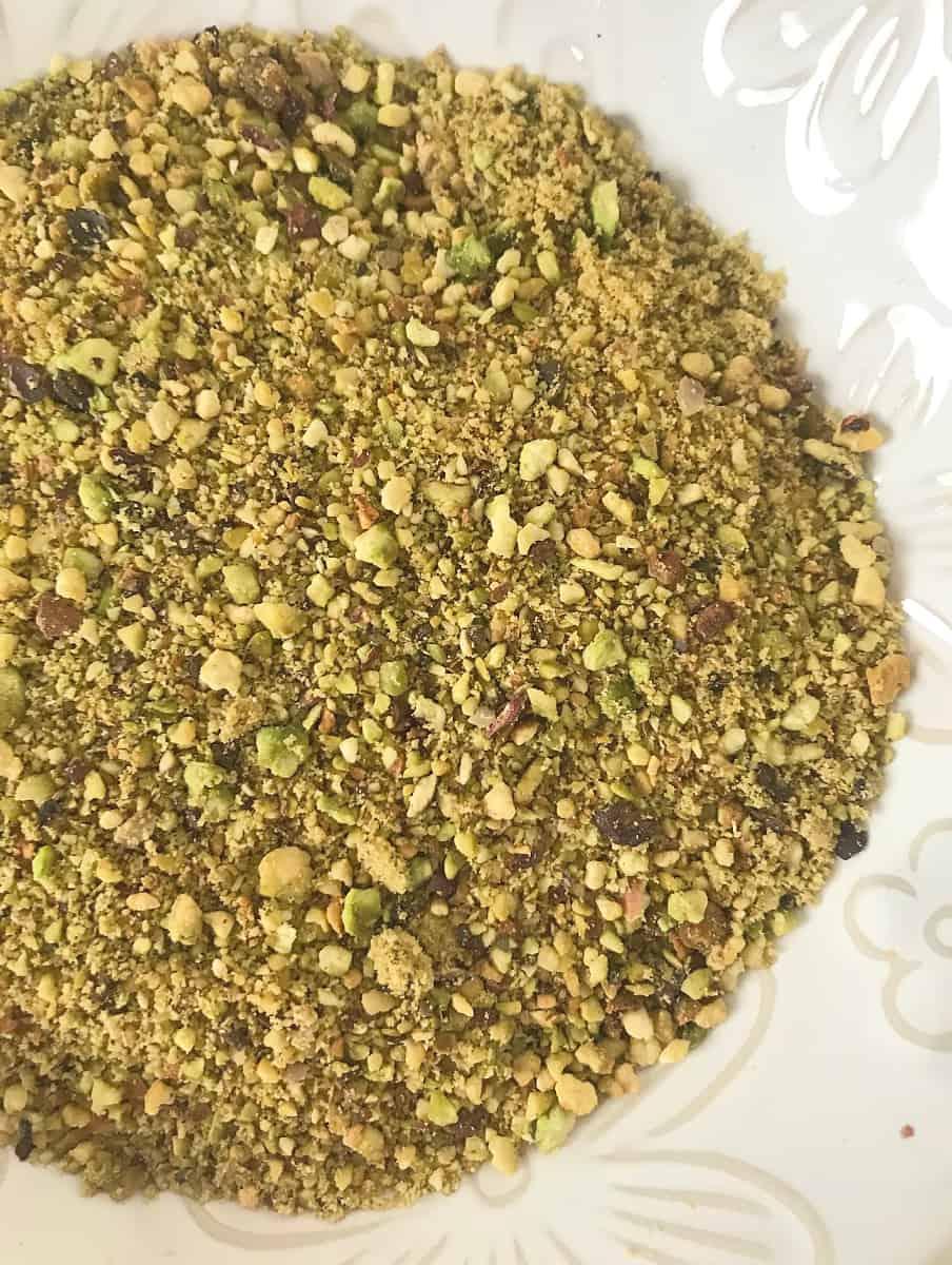 White bowl of ground pistachios