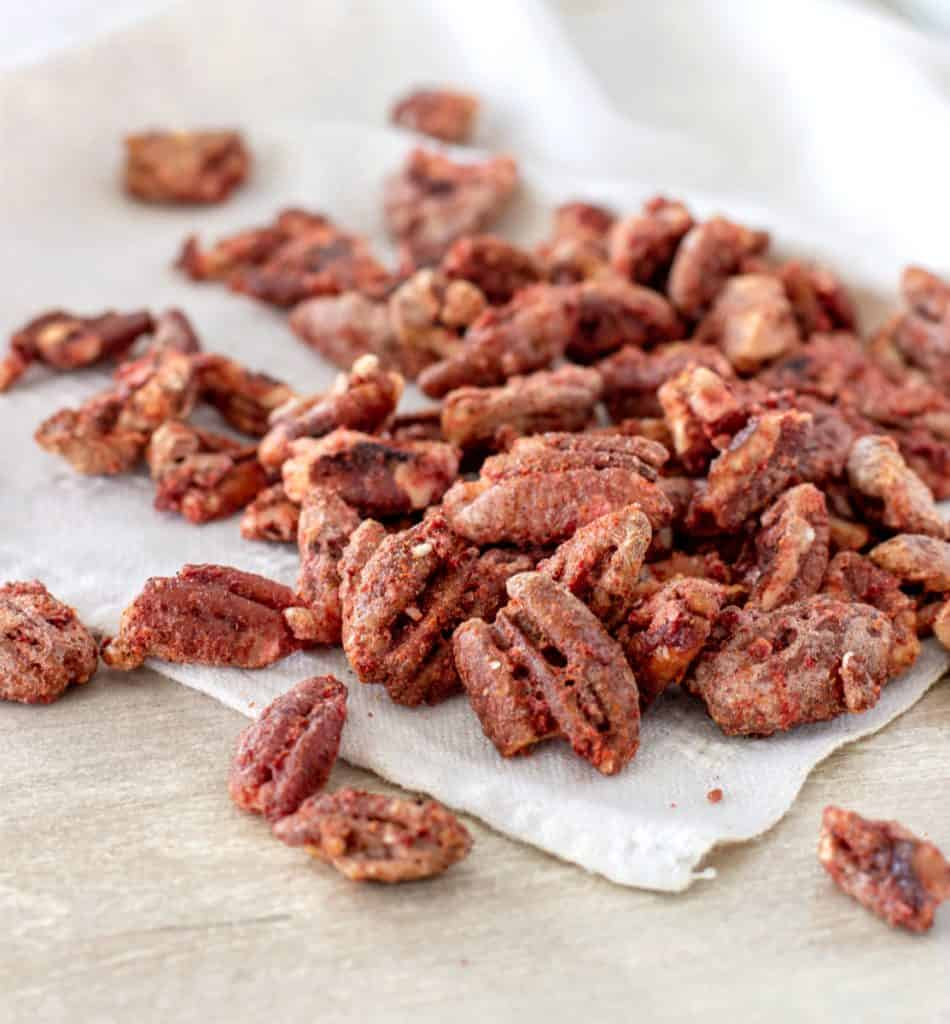 Bunch of cocktail pecans on white napkin