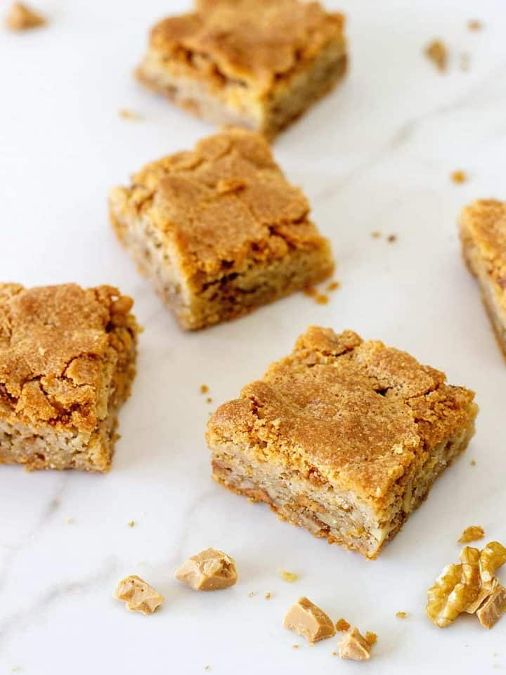 Blondie squares on white marble surface