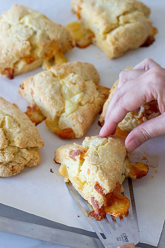 Lifting cheese scone from pan