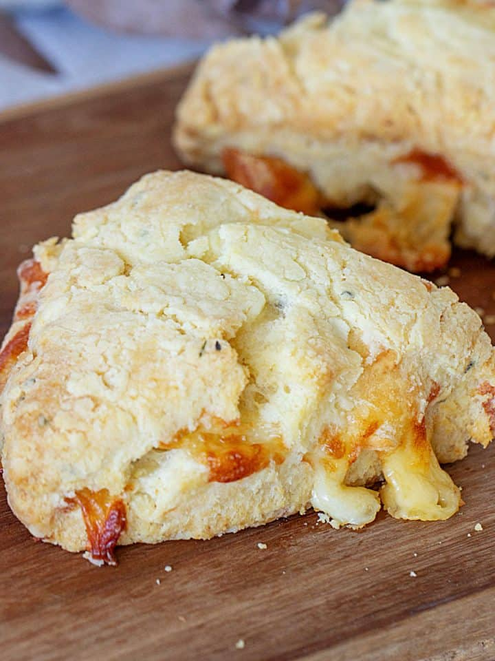 Baked cheese scone triangle on wooden board