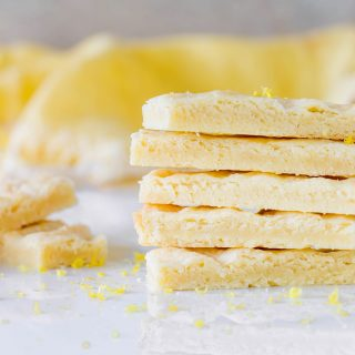 Shortbread fingers stacked on white surface