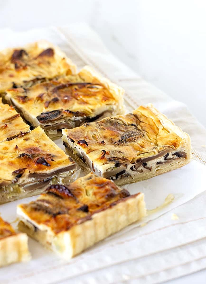 Mushroom quiche squares placed on top of a light colored cloth