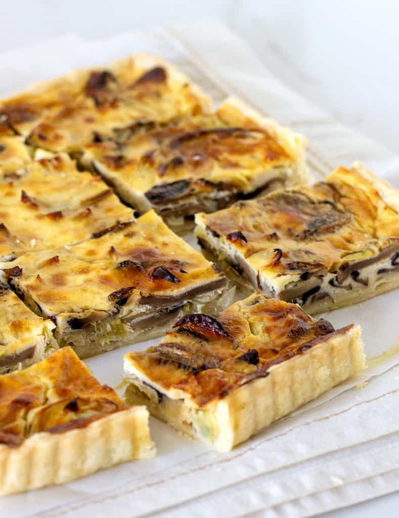 Mushroom quiche squares on light colored cloth