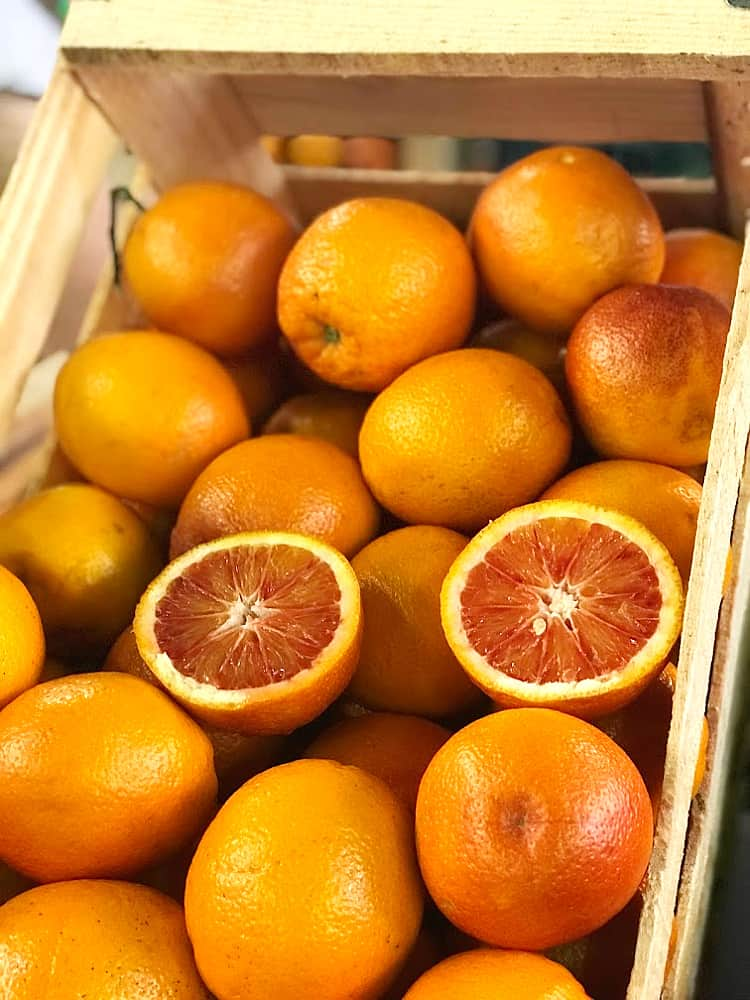 A wooden crate of blood oranges