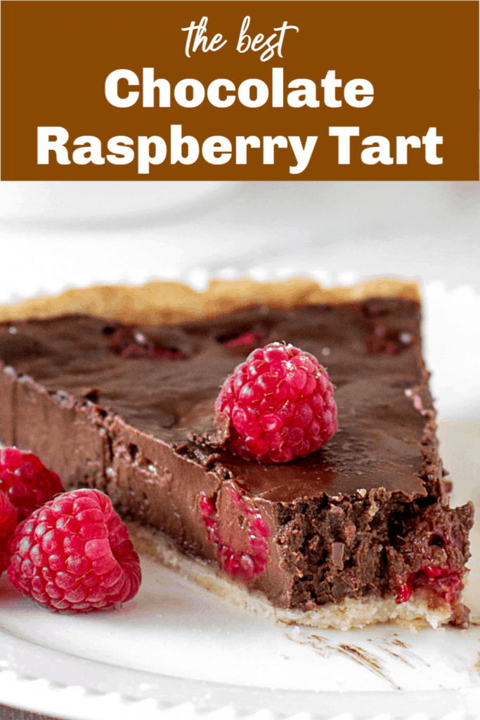 Slice of chocolate raspberry tart on white plate, pin with text