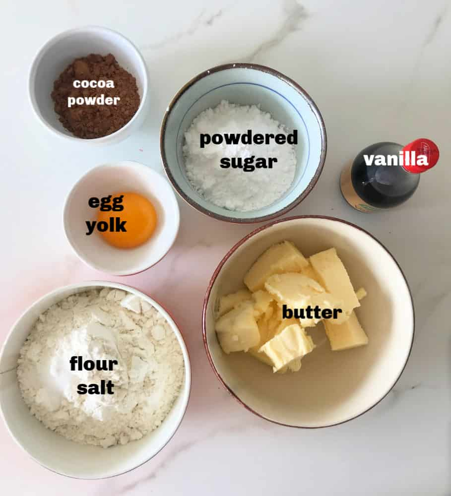 Chocolate pie crust ingredients in bowls on white surface