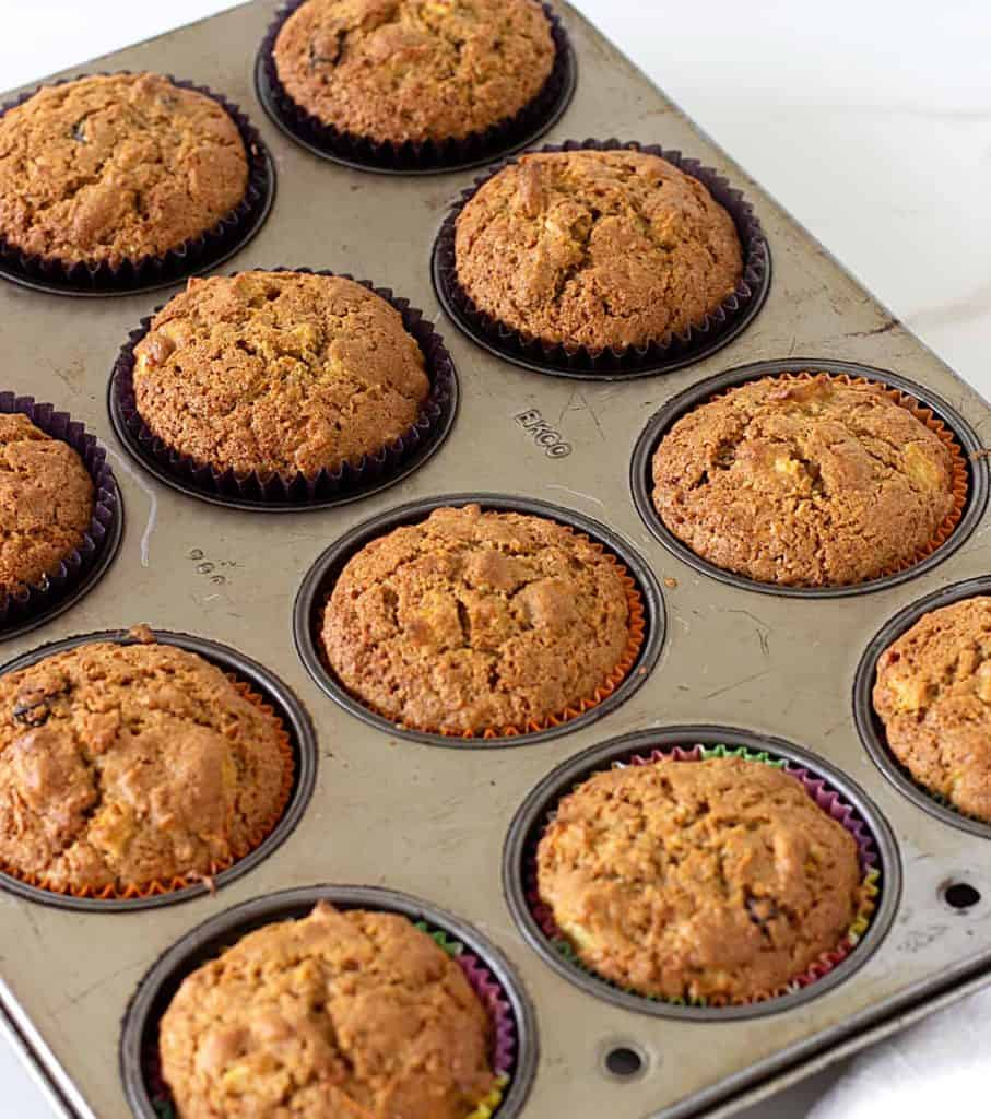 Baked muffins in metal pan