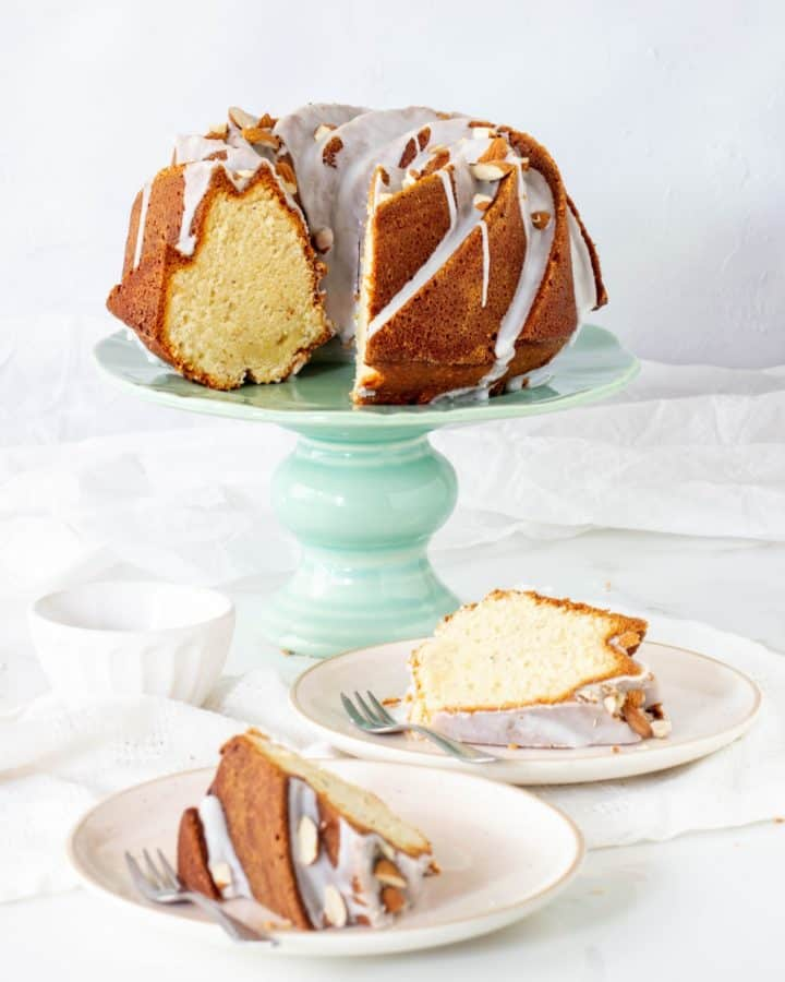 Green cake stand with glazed bundt cake, slices in plates, pin with text