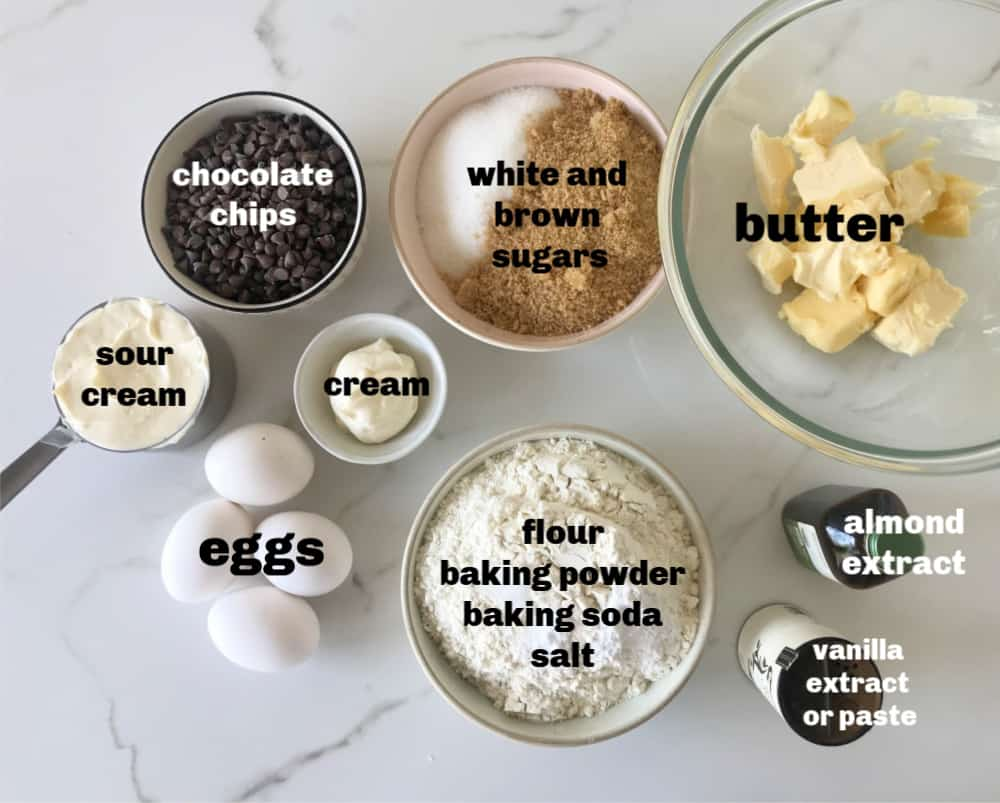 chocolate chip cake ingredients in bowls on white surface
