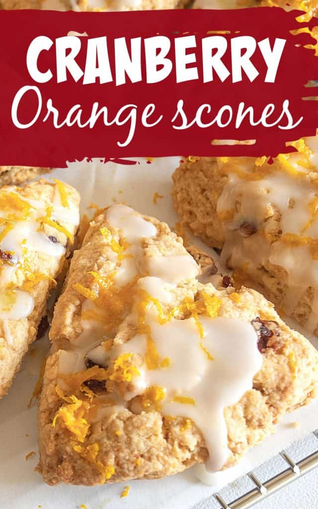 Close up of glazed scone triangle with orange zest, white and dark crimson text
