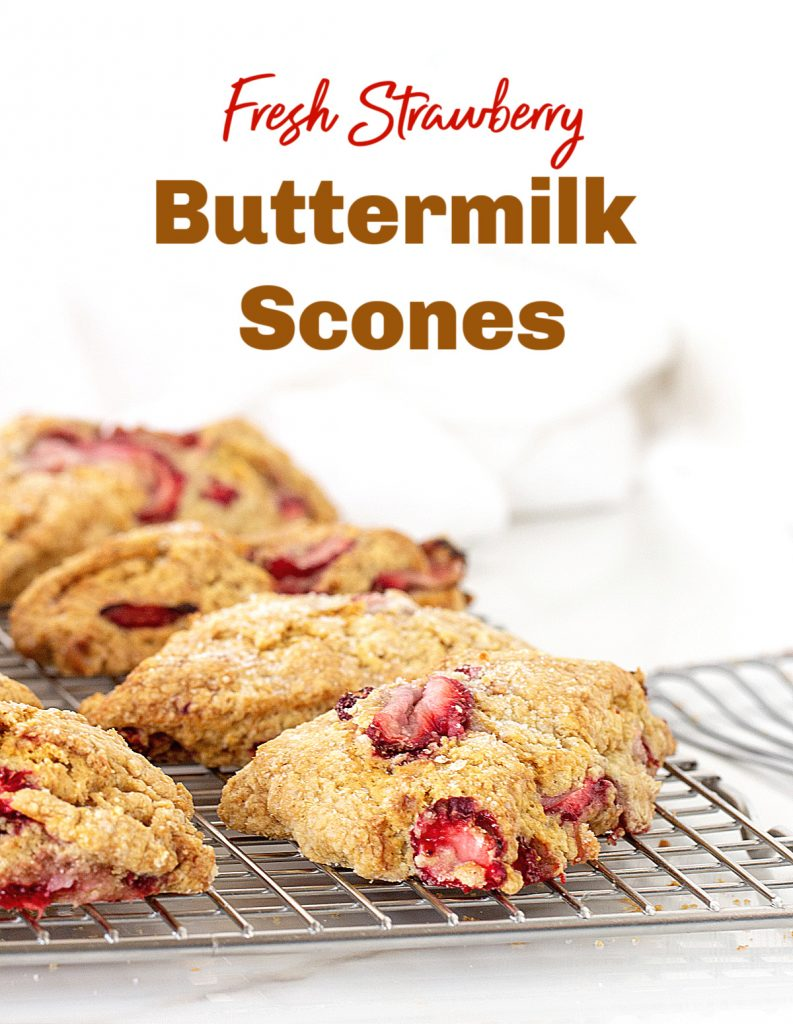 Strawberry scones on silver wire rack, white background, image with text