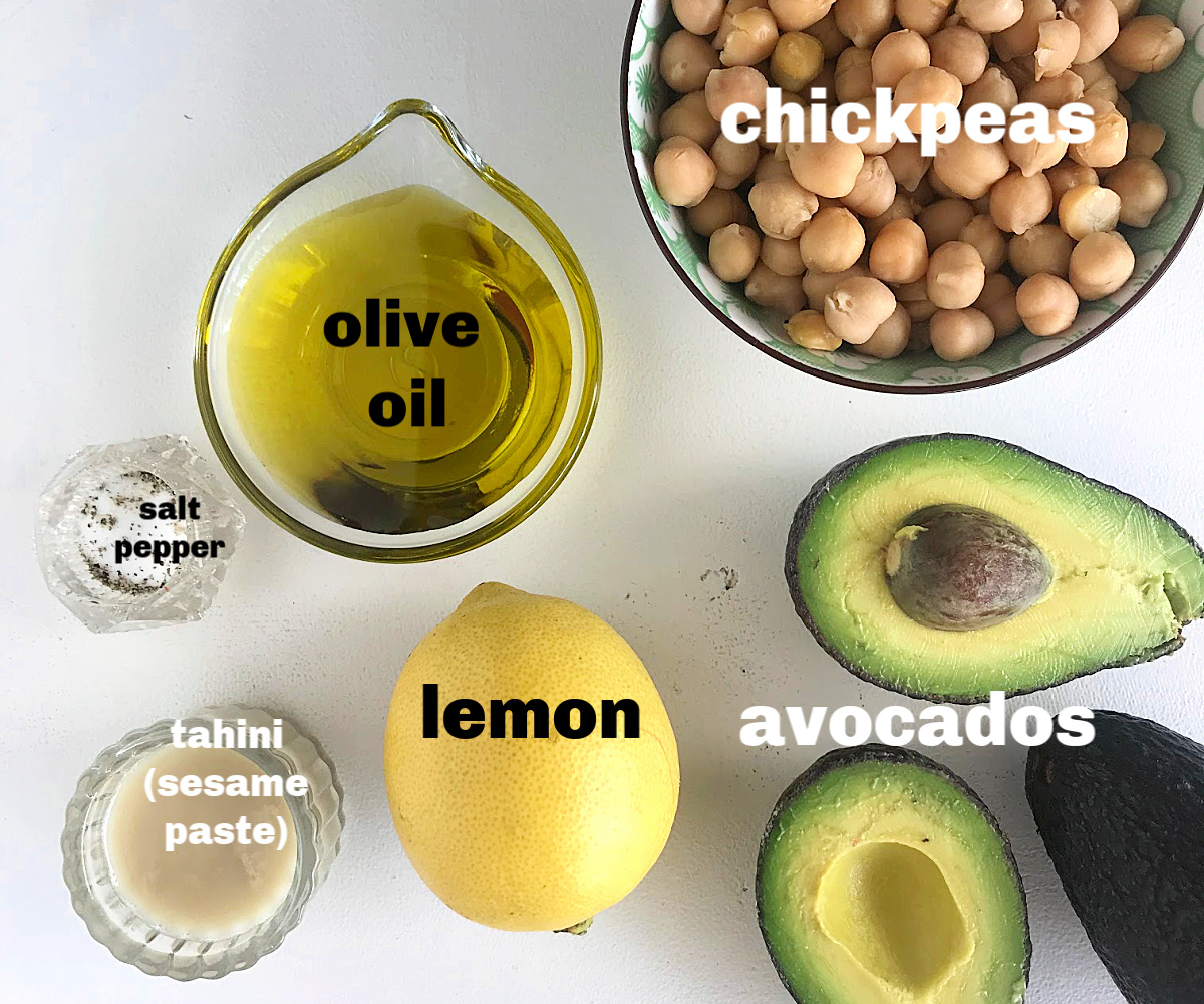 avocados, lemon, chickpeas, oil, in bowls on white surface