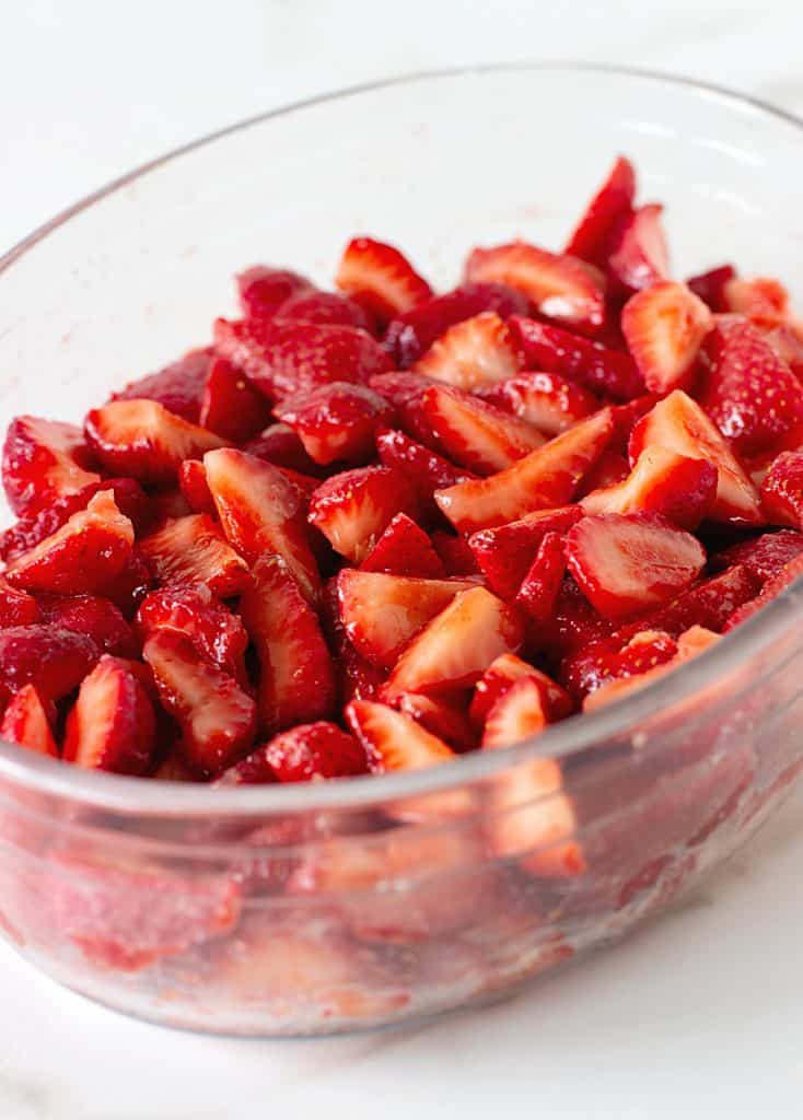 Glass oval dish with cut-up strawberries