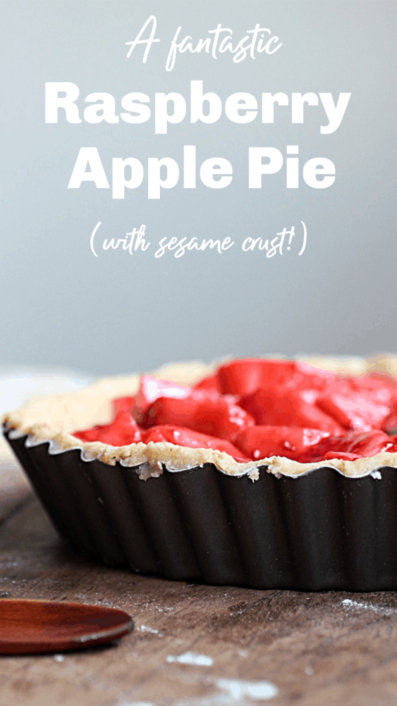 Unbaked pie on metal pan, red filling, wooden board; image with text
