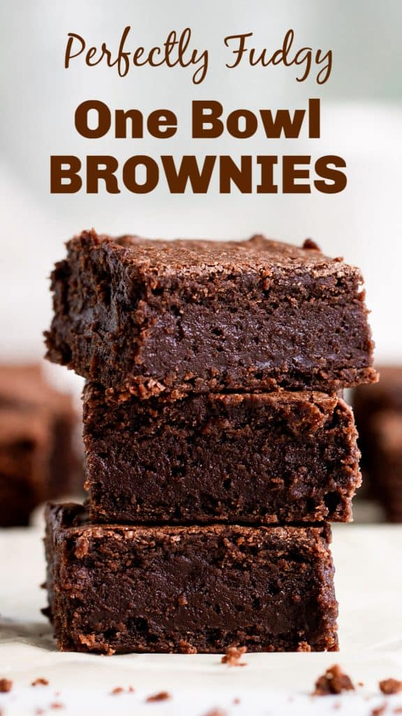 Stack of brownie squares on white surface; image with text