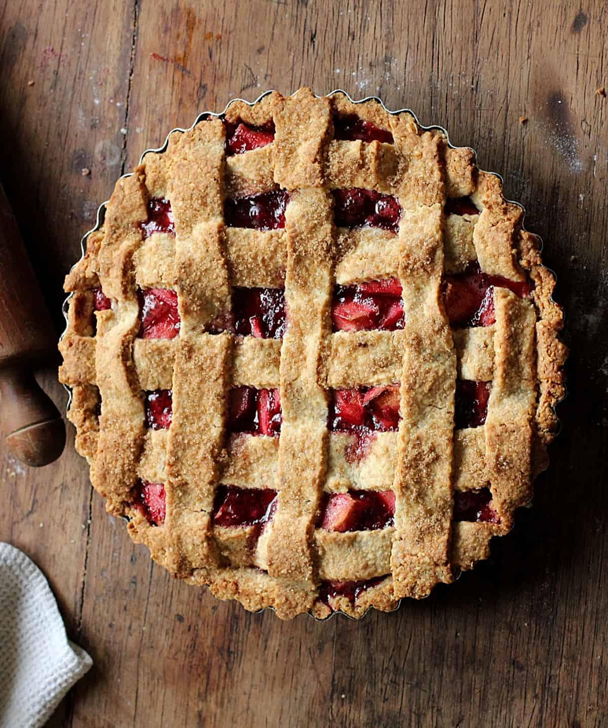 Whole lattice Pie on wooden table, rolling pin