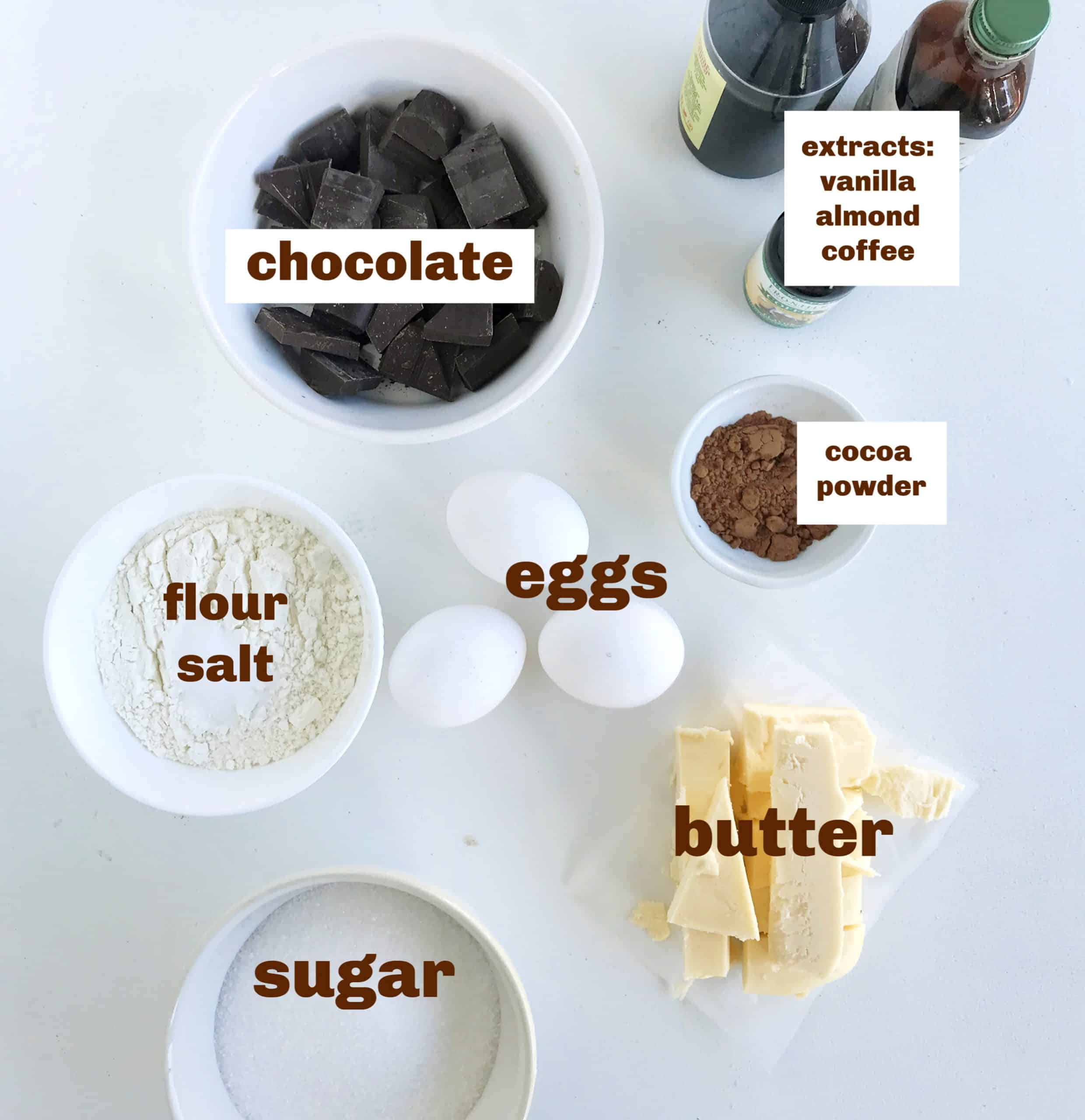 bowls with brownie ingredients, eggs, extract bottles, image with text
