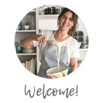round image of person smiling with apron, word welcome below