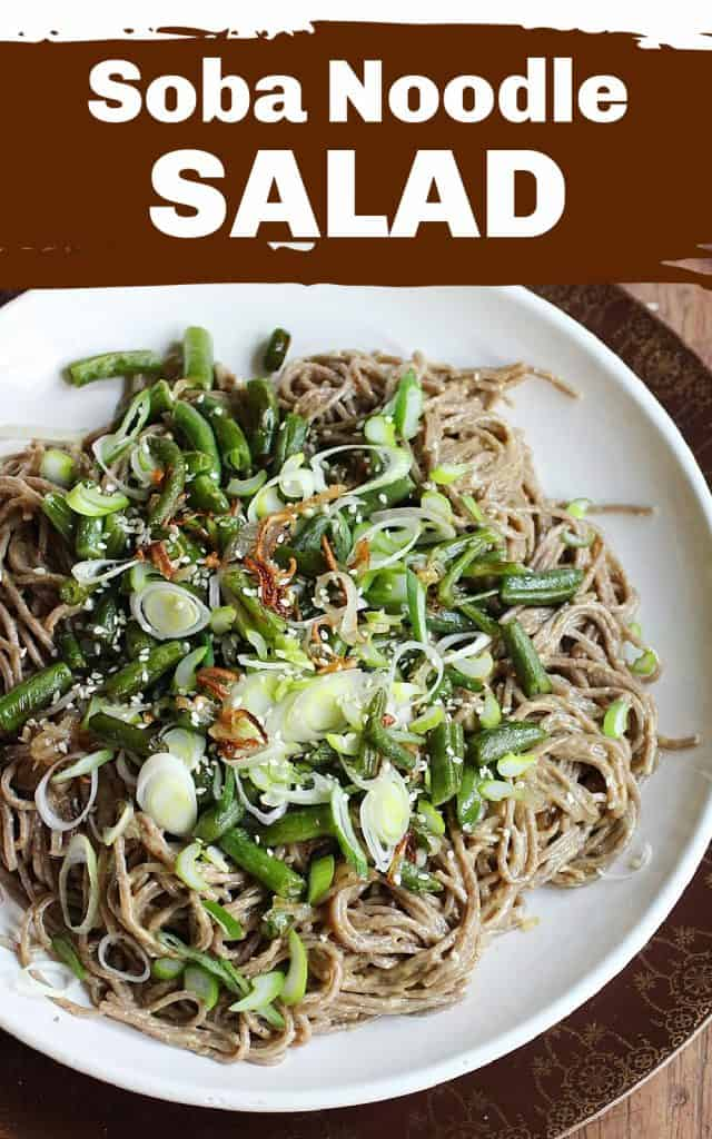 White plate of soba noodle salad with green beans, wooden table, image with text