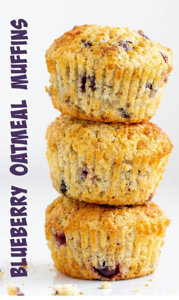 Three blueberry muffins in a stack on white background, text on the side