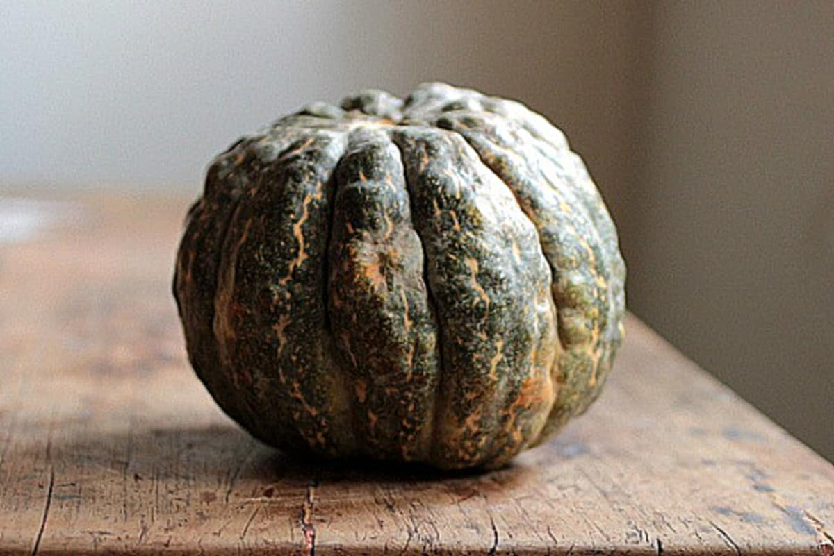Whole green English Pumpkin on a wooden table