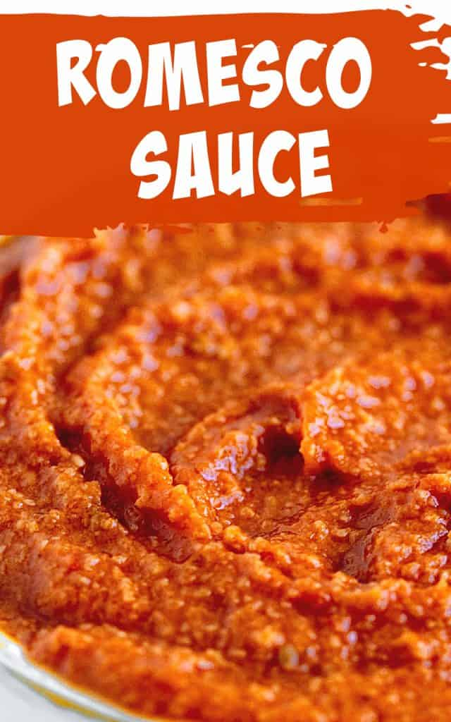 Close up of orange rustic romesco sauce; image with text