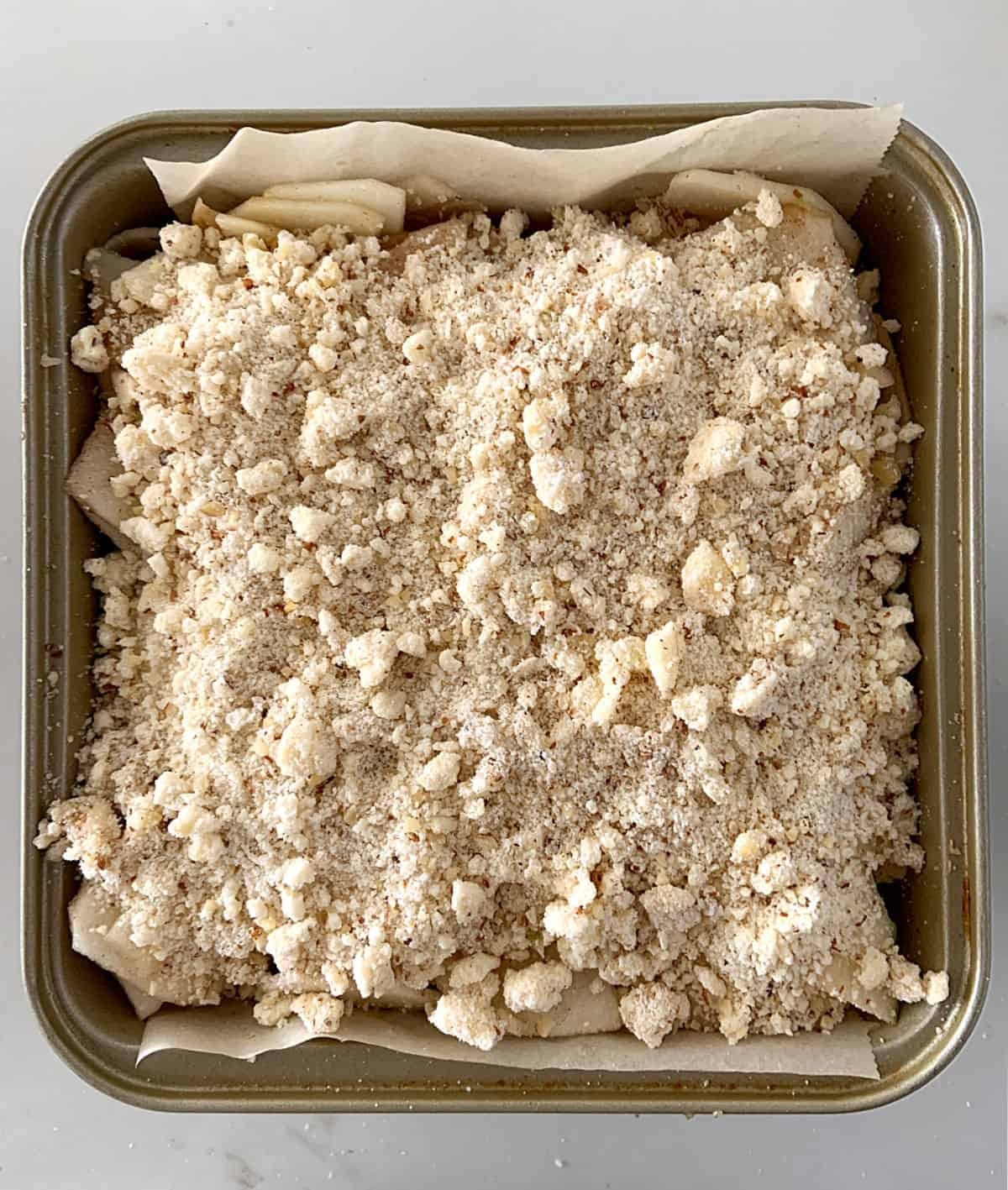 Raw crumble topping on square pan