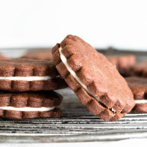 Close-up of round chocolate sandwich cookies on wire rack