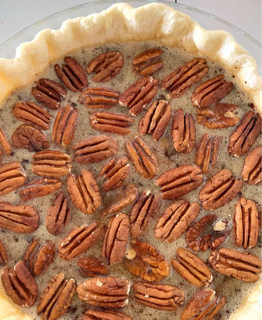 Partial view of unbaked pecan pie