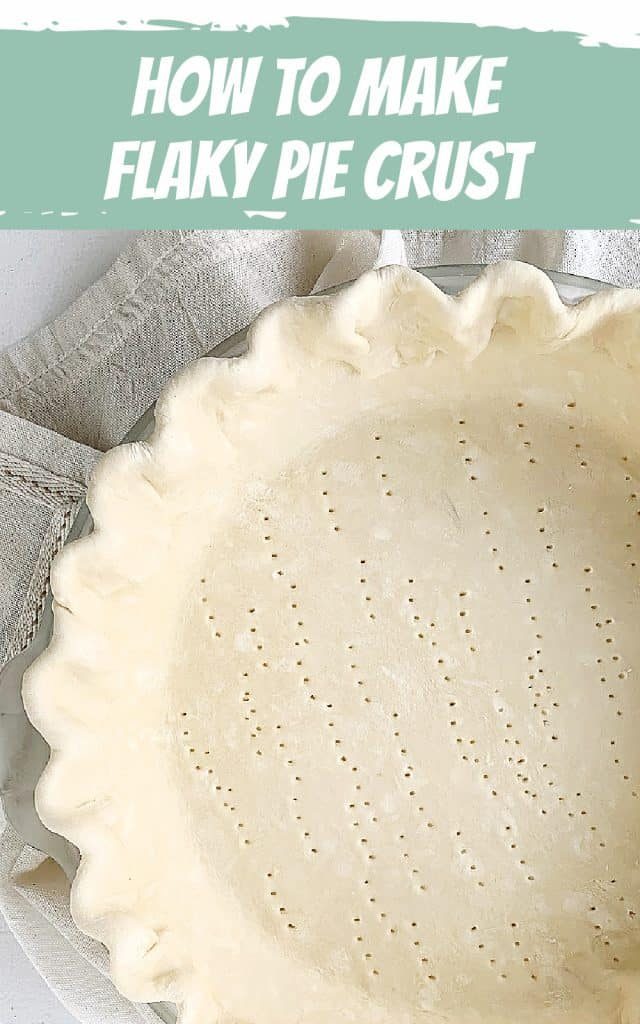 Close-up of partial pie crust with crimped edges, unbaked, green and white text overlay